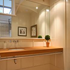 Neutral Transitional Bathroom With Simple Wood Countertop