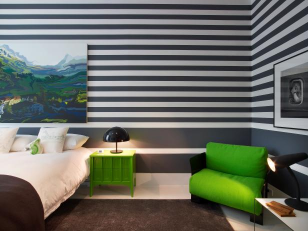 Modern Guest Room Features Striped Walls & Bold Green Accents