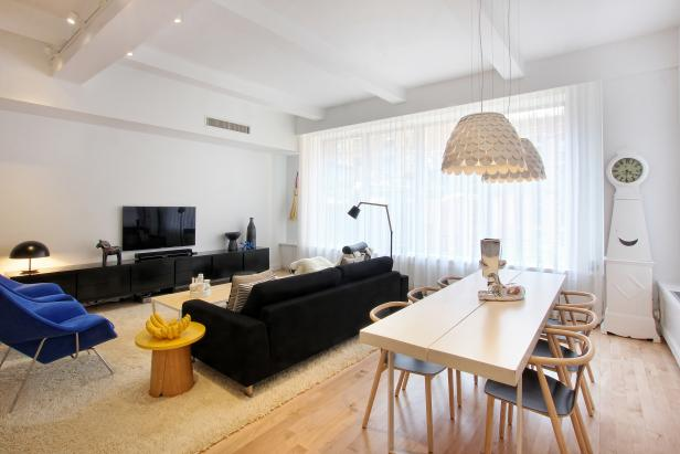 White Contemporary Living & Dining With Neutral Table & Black Sofa