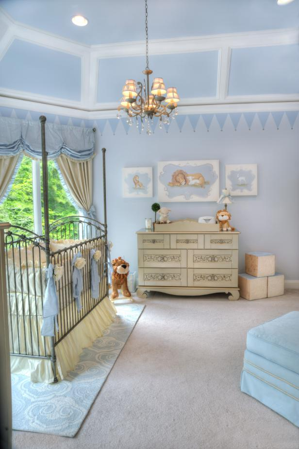 Traditional Light Blue Nursery With Chandelier and Pewter Iron Crib