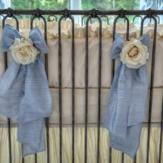 Elegant Pewter Iron Crib Adorned With Blue Bows