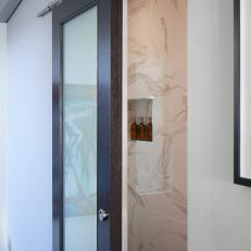 Wood and Glass Barn Door to Bathroom