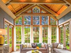 Neutral Transitional Great Room With Vaulted Wood Ceiling