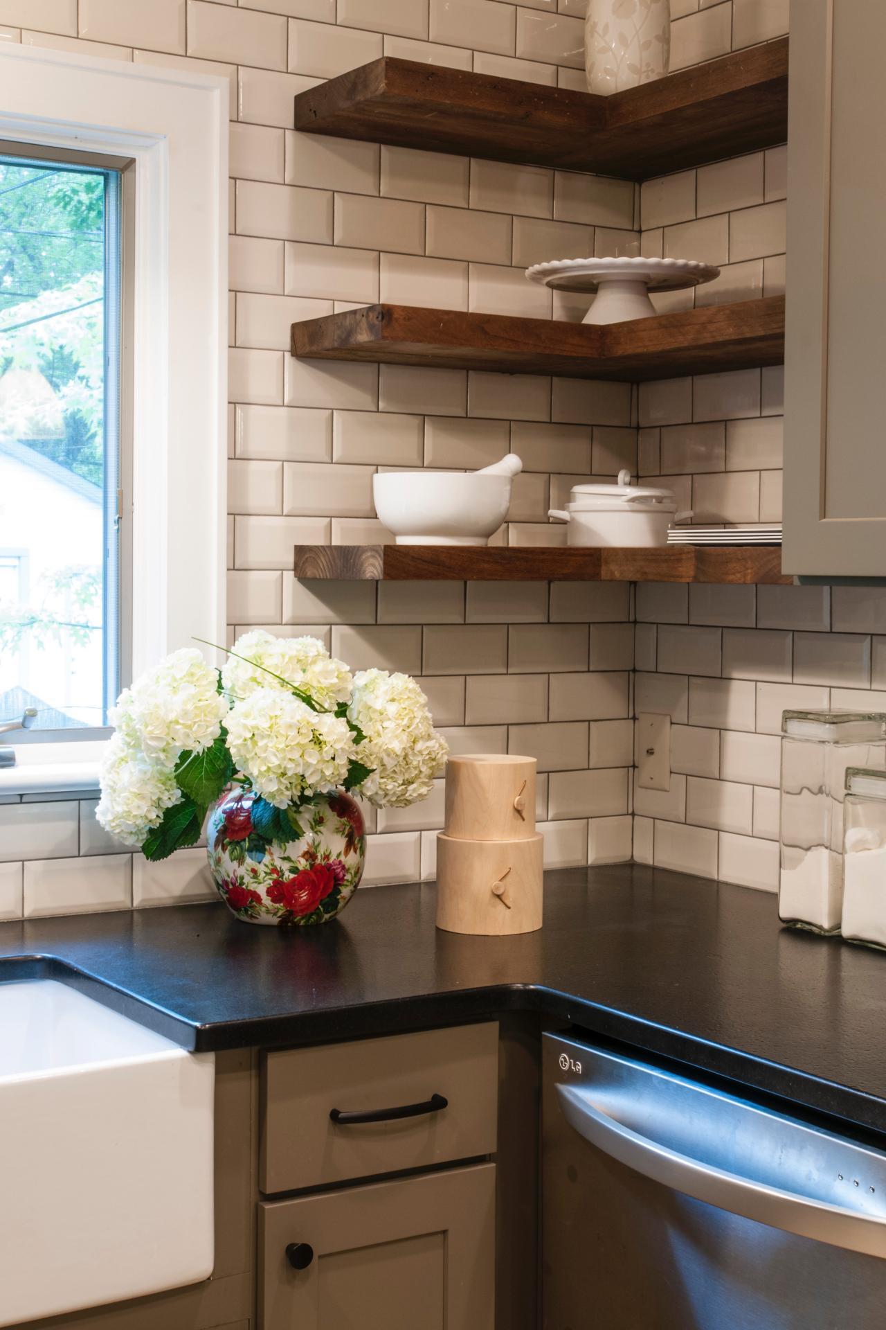 Black Kitchen Countertop And White Subway Tile Backsplash