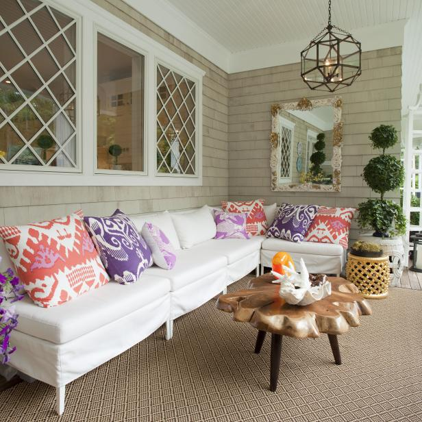 Neutral Porch With White Sofa and Purple, Pink & Red Pillows