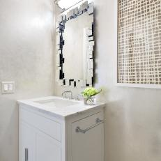 Contemporary Powder Room With Unique Mirror
