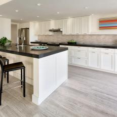 Contemporary White Kitchen With Thick Black Countertops