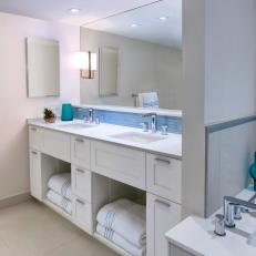 Contemporary Neutral Bathroom With Bright Pops of Blue