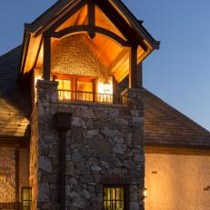 Home Exterior at Night With Stone Column