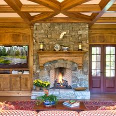 Neutral Rustic Living Room With Stone Fireplace