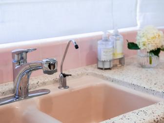Pink Kitchen Sink With White Countertop