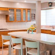 Neutral Midcentury Kitchen With White Tile Backsplash