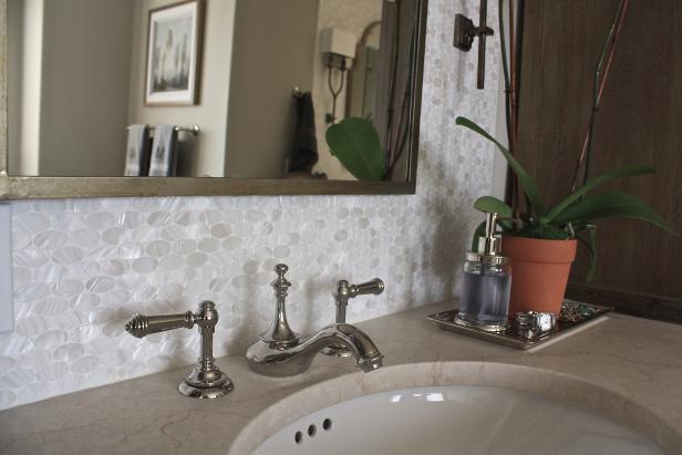 White Bathroom Vanity With Oval Tile Backsplash Hgtv