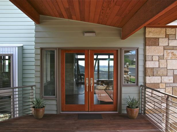Contemporary Green Exterior With Wood-Framed Glass Doors