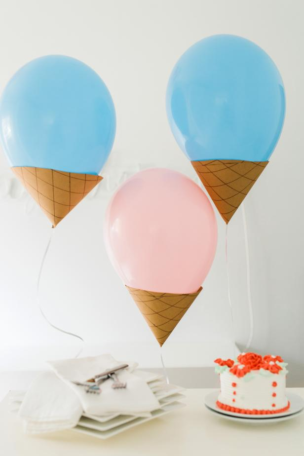 These floating cones are a sweet way to decorate for an ice cream party! You'll need: latex balloons, a bottle of latex balloon sealant, helium tank, ribbon, scissors, craft knife, brown craft paper, brown wide-tip marker, pencil and double-sided tape.