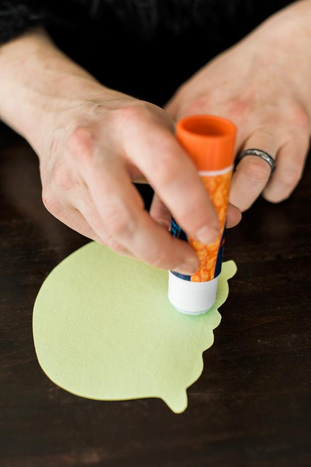 Use the glue stick to apply a thin layer of glue to the bottom of the scoop and attach to the top of the cone.