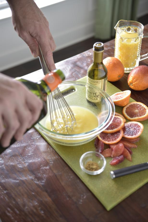 Pour the orange juice and white wine vinegar into a small bowl. Slowly whisk in the olive oil until it is emulsified. (Or place all ingredients in a jar, cover and shake!)