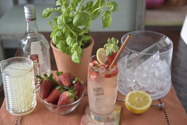 Spring Cocktail With Strawberries, Lemon & Mint Leaves