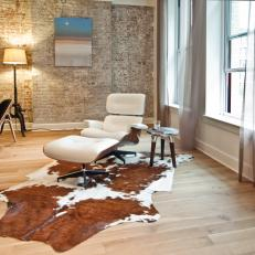 Eames Lounge Chair & Cowhide Rug in Stylish Living Room