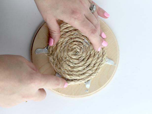 Continue to glue and wrap until the entire wooden circle is covered in rope.