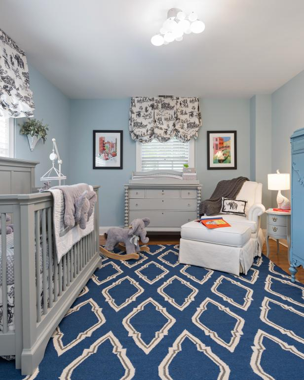 Blue Transitional Nursery With Blue Rug, Gray Crib & Changing Table