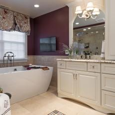 Elegant Burgundy Bathroom Features Freestanding Bathtub