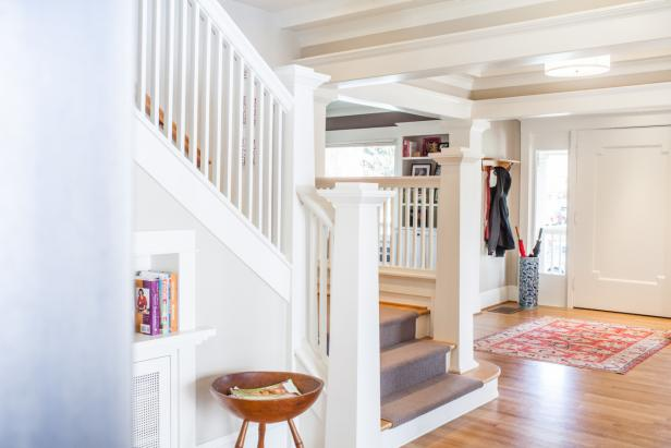 Neutral Transitional Foyer With White Staircase