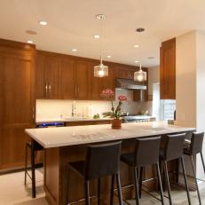 Brown and White Transitional Open Plan Kitchen With Barstools