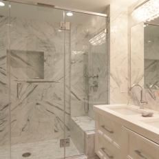 Luxurious Marble Walk-In Shower and Floating Vanity