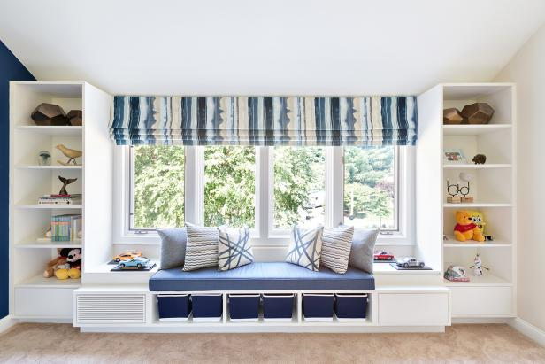 Contemporary Blue & White Kids Room With White Bookcases & Window Seat