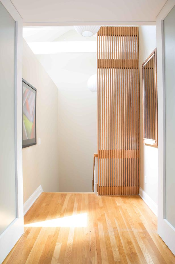 Hall With Slatted Half Wall Leading to Master Suite