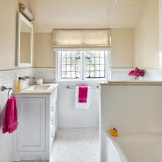 Soft-Hued Hall Bathroom in Cream and White