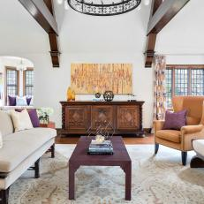 Great Room Features Exposed Beams and Regal Purple Accents