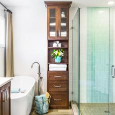 Tall Linen Cabinet Offers Storage in Transitional Bathroom