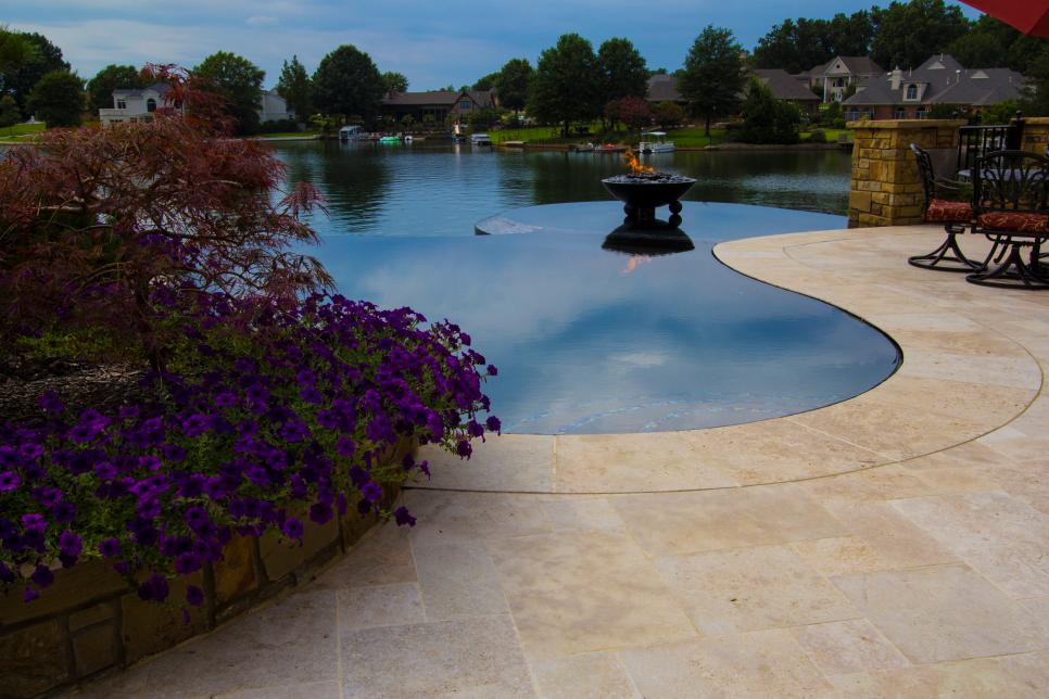 Infinity Pool and Travertine Patio With Lakefront View