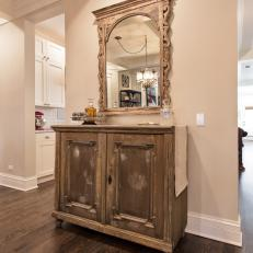 Distressed Wood Buffet and Ornamental Mounted Mirror