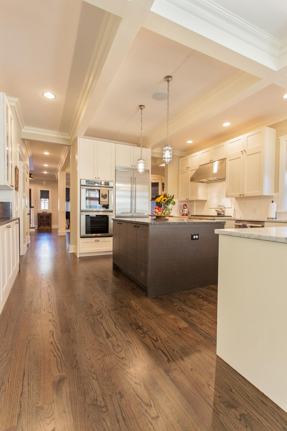 Transitional White Kitchen With Brown Island