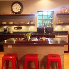 Light Wood Island With Red Barstools in Transitional Kitchen