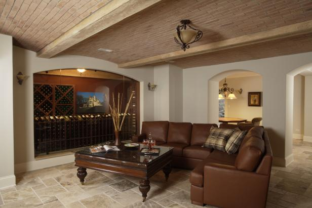 Traditional Sitting Room With Brown Sectional & Wine Cellar View