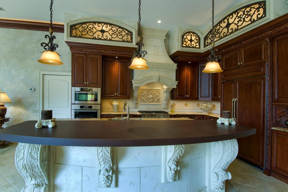 Mediterranean Neutral Kitchen With Brown Cabinets and Pendant Lights