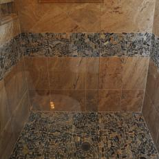 Neutral Tile Shower Boasts Sliced Pebble Accents