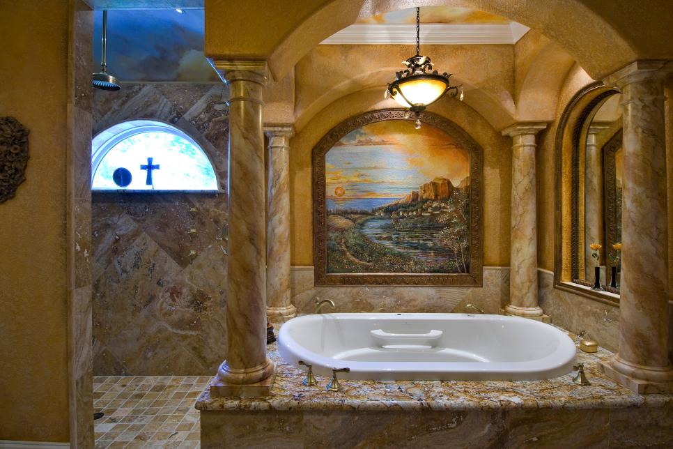 Tuscan Bathroom With Large Bathtub, Stone Columns and Painting