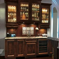 Traditional Wet Bar With Lighted Glass Front Cabinets