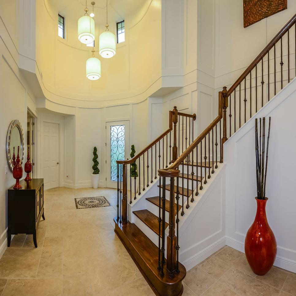Eclectic, Two-Story Foyer With Wooden Staircase