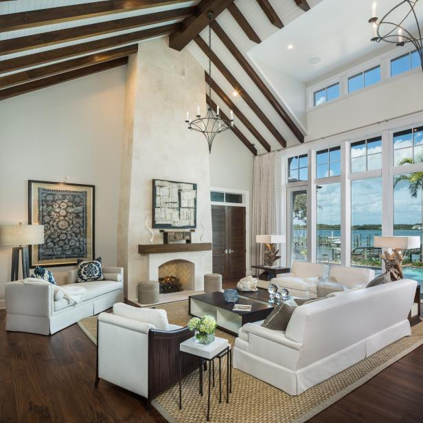 Neutral Living Room With Tall Ceilings, White Furniture and Bay View