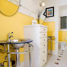Striking Yellow Bathroom Boasts Modern Console Sinks