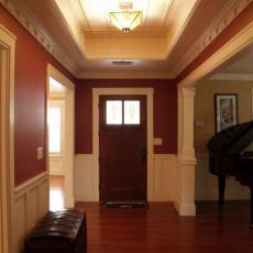 Craftsman-Style Foyer With Crimson Walls