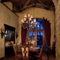 Grand Tuscan Dining Room Boasts Elegant Chandeliers