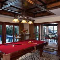 Sophisticated Tuscan Game Room Boasts Red Felt Pool Table
