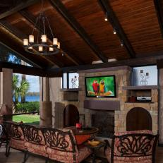 Tuscan-Style Outdoor Living Room Boasts Fireplace & TV